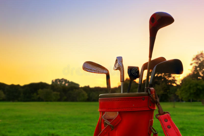 Professional golf clubs at sunset stock photo