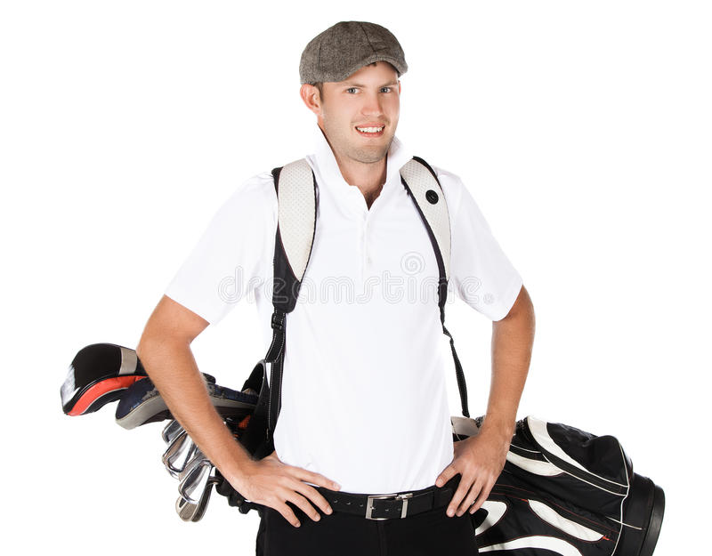 Professional golf player. Handsome young professional golf player wearing a white shirt and black pants. He is carrying a golf bag on his back and is smiling royalty free stock image