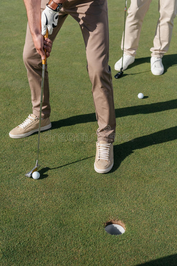 Professional golf players getting ready to shot a ball royalty free stock photo