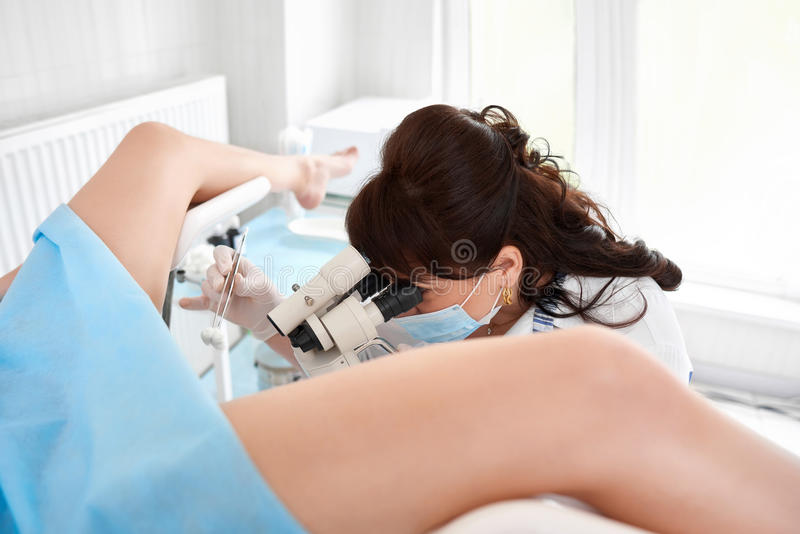 Professional gynecologist examining her patient. Professional gynecologist examining her female patient on a gynecological chair royalty free stock photo