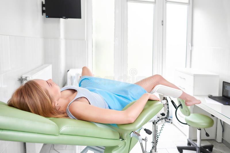 Professional gynecologist examining her patient. Rearview shot of a woman lying on gynecological chair waiting for medical examination copyspace gynecology stock image