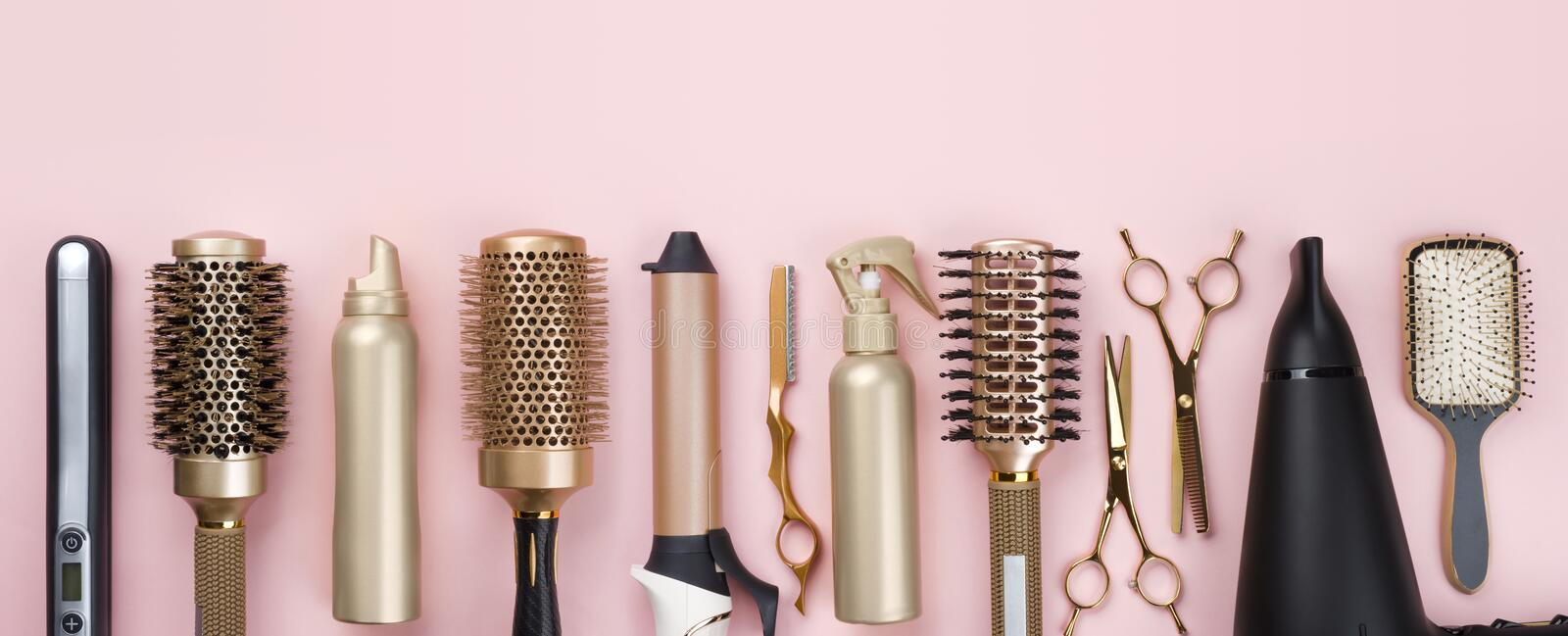 Professional hair dresser tools on pink background with copy space royalty free stock images