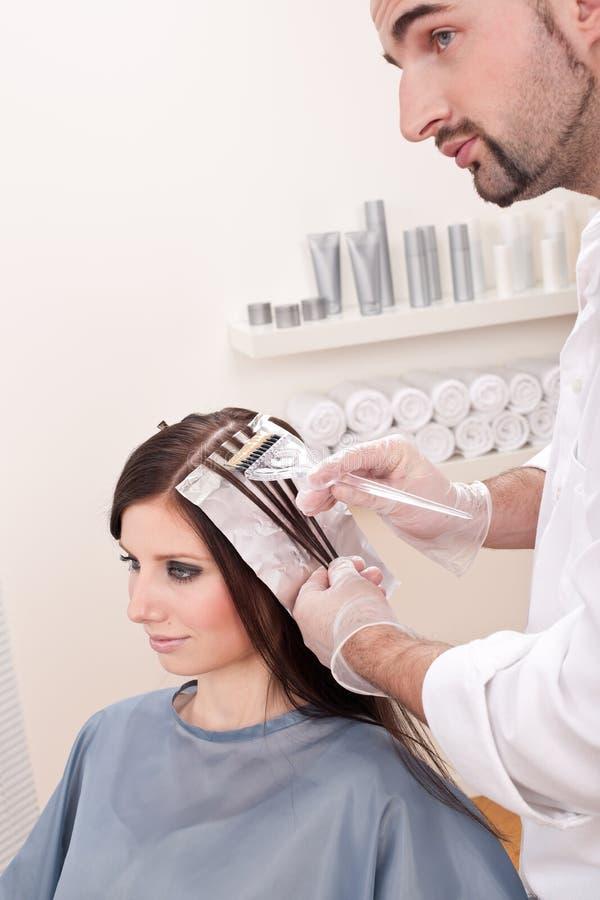 Professional hairdresser color customer at salon stock photos