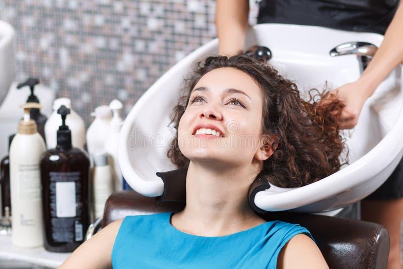 Nice Girl Washing Her Head In Beauty Salon Stock Image