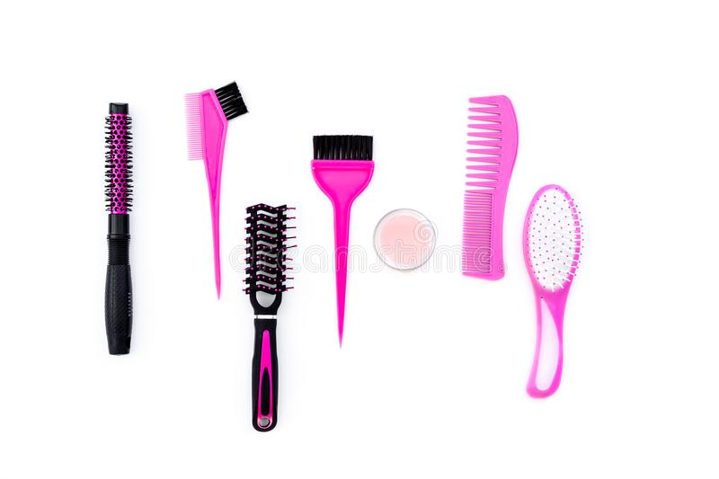 Professional hairdressing tools in beauty saloon. Combs, brushes on white background top view stock images