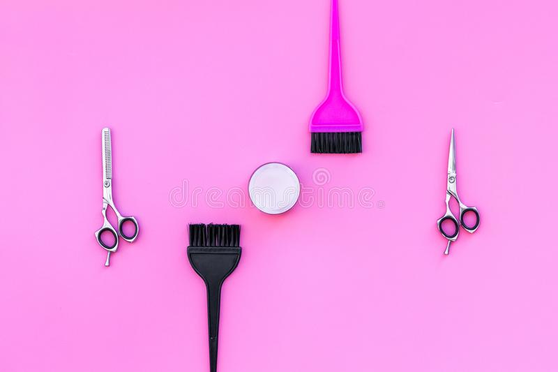 Professional hairdressing tools in beauty saloon. Sciccors, brushes on pink background top view copy space stock image