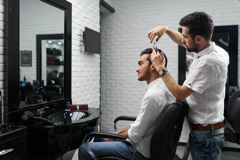 download professional hairstylist is cutting the clients hair with scissors stock image image of brush