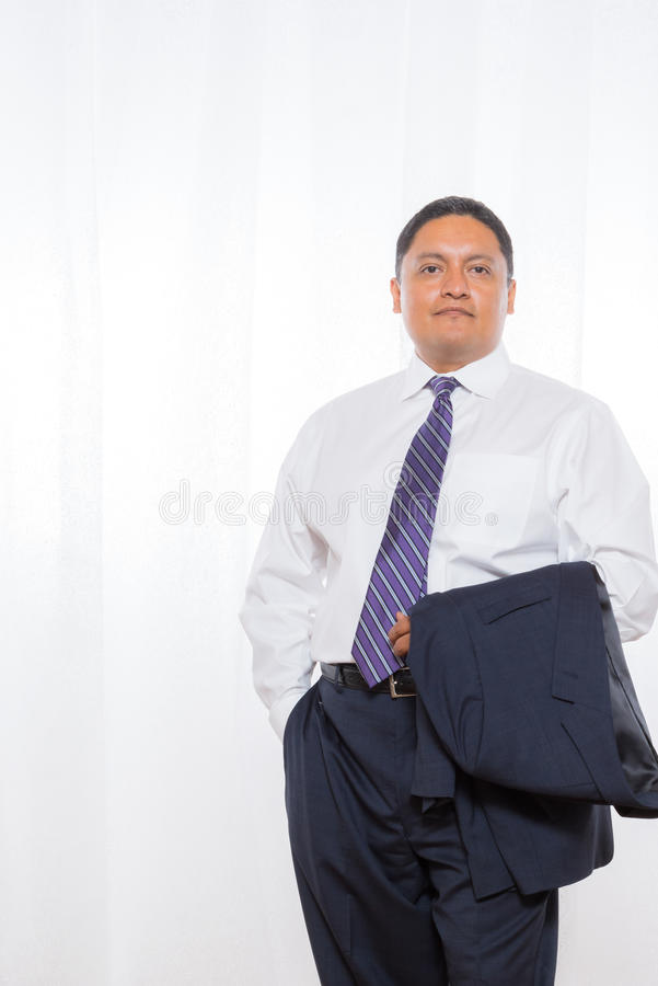 Professional Hispanic Male In Suit With Confident Expression stock photography