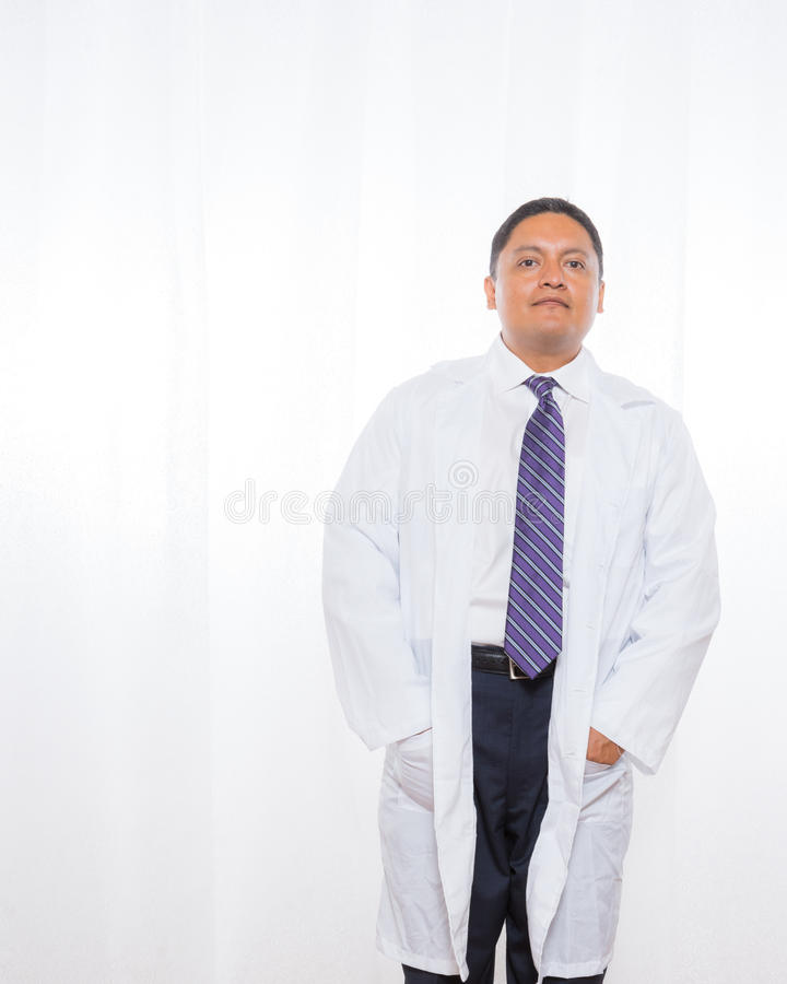 Professional Hispanic Male Wearing Lab Coat royalty free stock photo