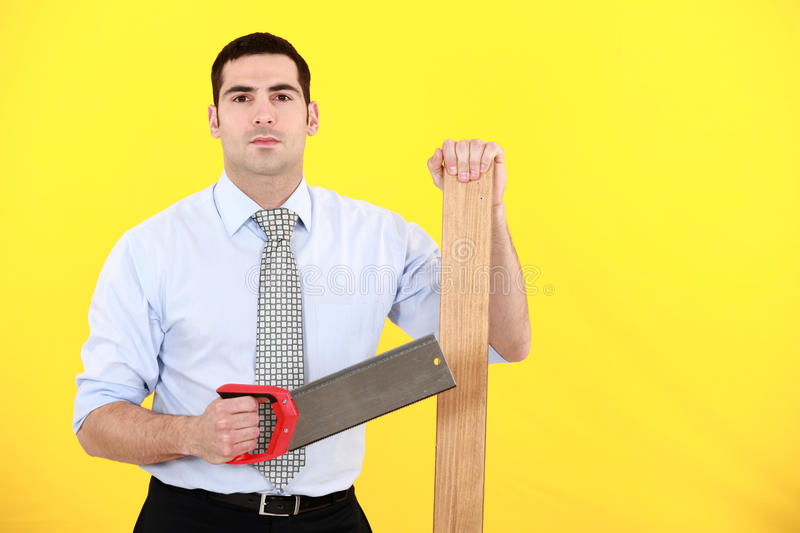 Professional Holding A Saw Royalty Free Stock Photos