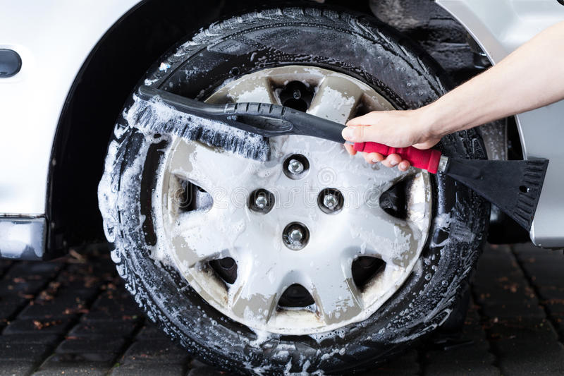Professional hubcap cleaning. Horizontal view of a professional hubcap cleaning royalty free stock image
