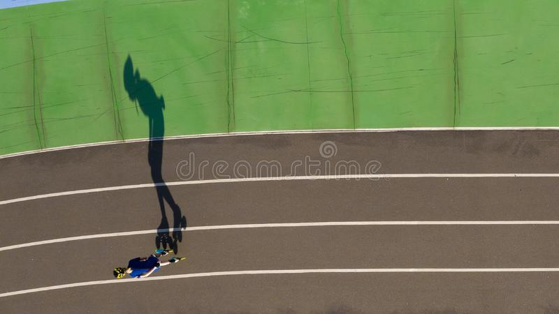 Professional inline skating training. Top view shadow original design. Sport poster royalty free stock images
