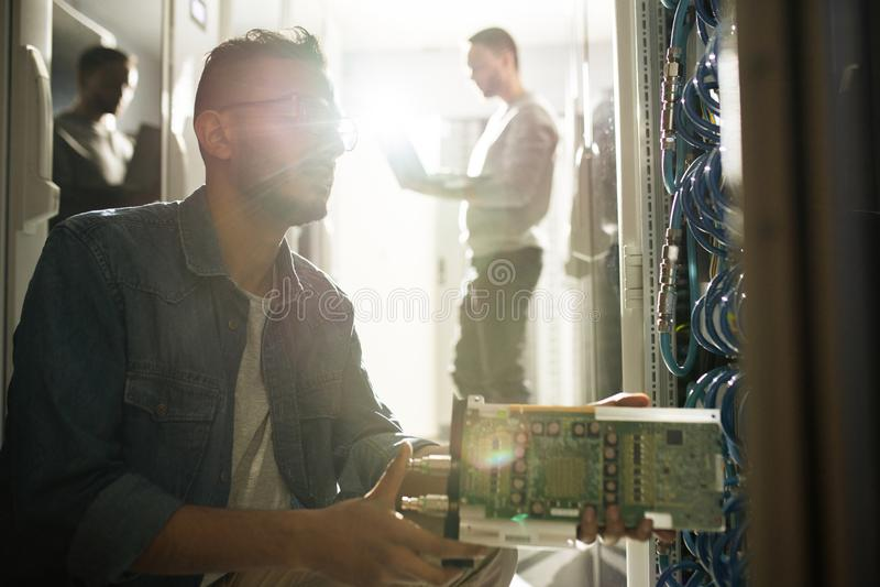 IT professional installing blade server stock photo