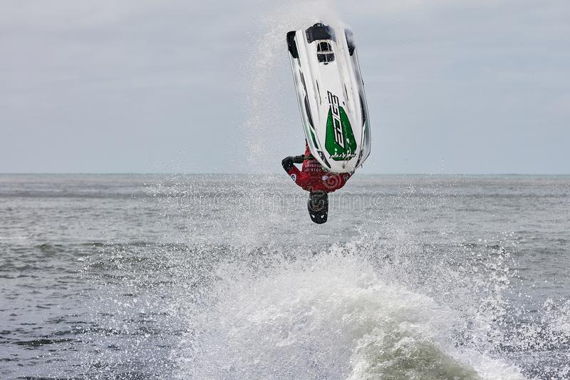 Professional jet ski riders compete at the IFWA World Tour. Jet Ski Championship. Contestants perform tricks for judges in the waves. Freeride World royalty free stock image