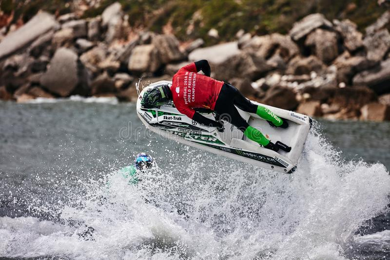 Professional jet ski riders compete at the IFWA World Tour. Jet Ski Championship. Contestants perform tricks for judges in the waves. Freeride World royalty free stock photos
