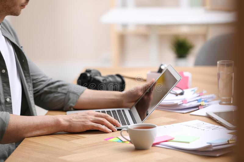 Professional journalist working with laptop in office royalty free stock photos
