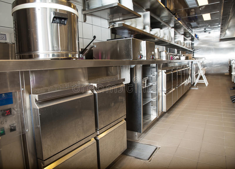 Professional kitchen, view counter in steel stock photography