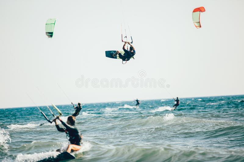 Professional kiter makes the difficult trick on a beautiful background. stock image
