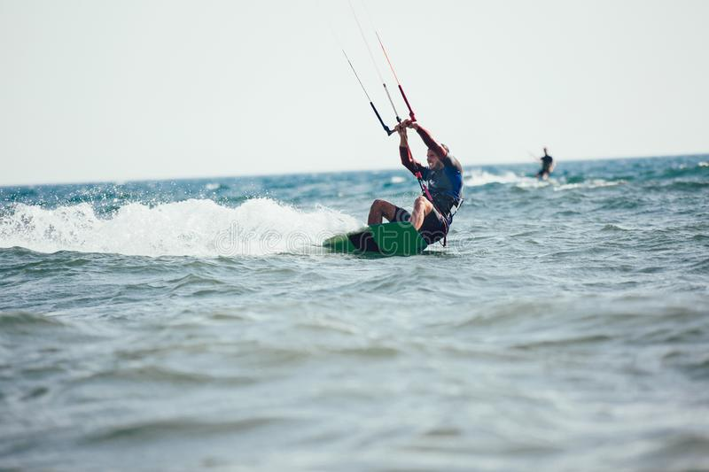 Professional kiter makes the difficult trick on a beautiful background. royalty free stock photos