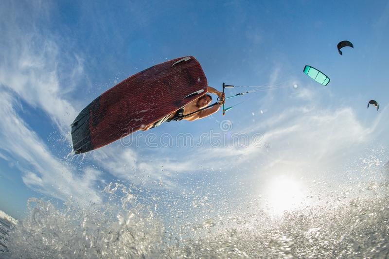 Professional kiter makes the difficult trick stock image