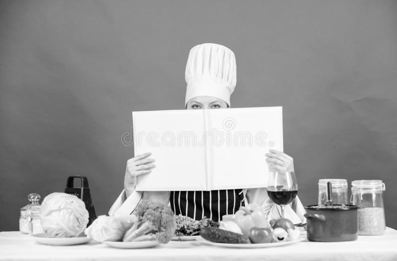 Professional level. Woman study culinary. Culinary expert. Chef cooking healthy food. Cooking techniques. Cook read book. Best culinary recipes. Culinary school stock photo