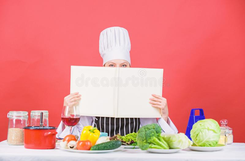 Professional level. Woman study culinary. Culinary expert. Chef cooking healthy food. Cooking techniques. Cook read book stock photography