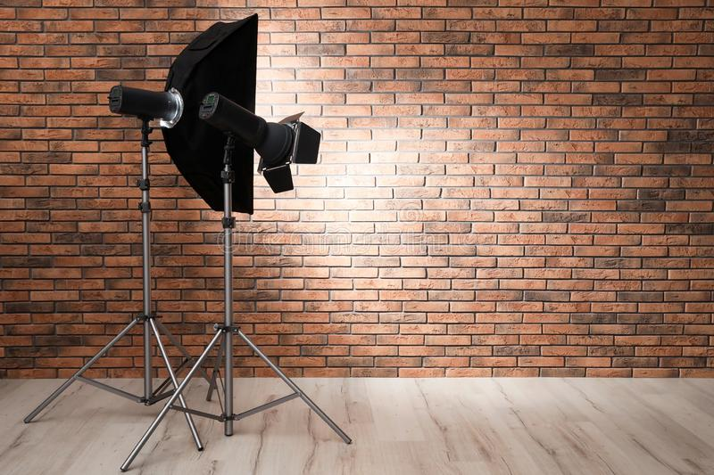 Professional lighting equipment near wall in photo studio. royalty free stock photography