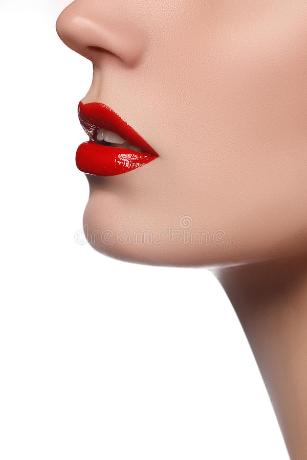 Professional lips make-up. Lipgloss and brush. Lipstick. Beauty girl applying lip gloss. lips. Beauty red lip makeup royalty free stock image