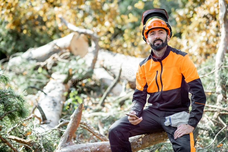 Professional lumberman resting in the forest stock photo