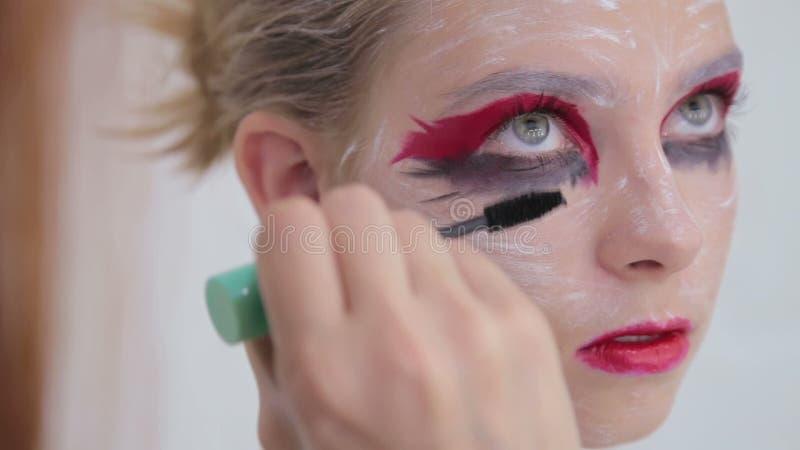 Professional Make Up Artist Applying Mascara On Eyelashes Of Model