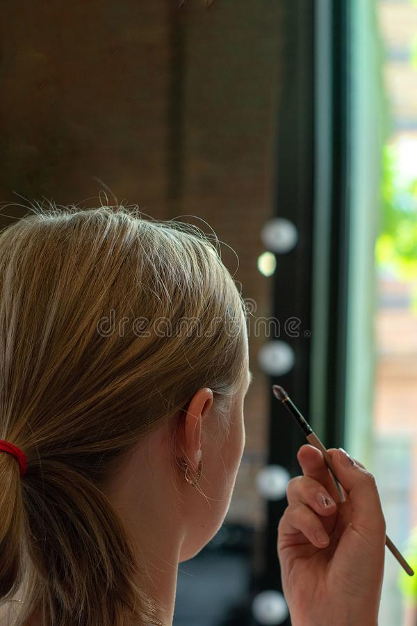 Professional make up artist doing make up in beauty salon stock images