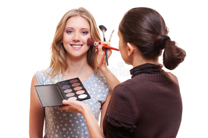 Professional make-up artist working with model stock photos