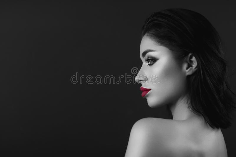 Professional make up brunette girl. Black and white only red lips royalty free stock photos