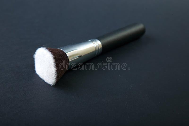 Professional make-up brush on black background, natural cloth, m stock photo