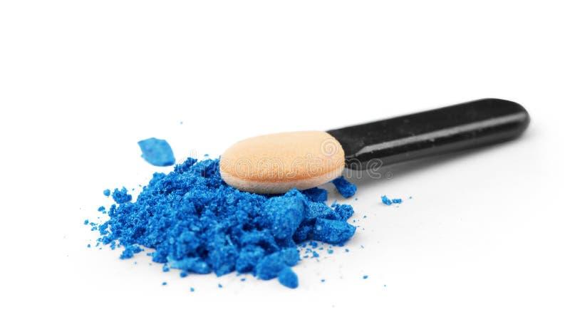 Professional make-up brush on blue crushed eyeshadow stock image