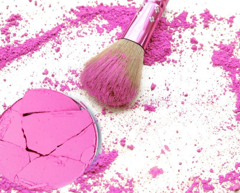 Professional make-up brush on purple crushed make up powder. royalty free stock photography