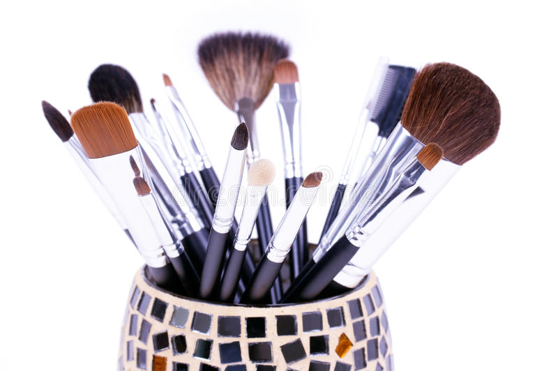Professional make-up brushes in mirror can stock image