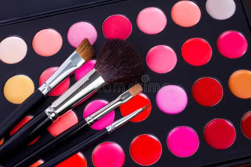 Professional make-up multicolor palette with brush stock images