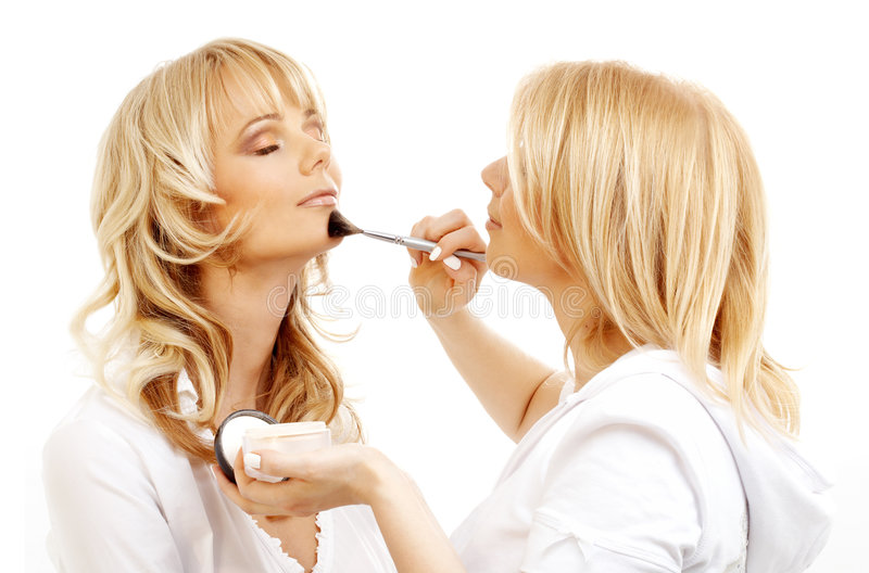 Professional makeup artist at. Lovely blond at professional makeup studio