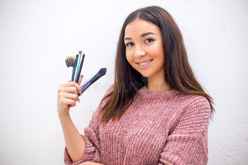 Professional makeup artist with her eyebrushes and other instruments stock images