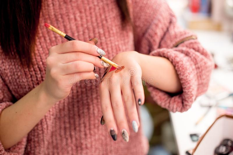 Professional makeup artist working on young girl stock images