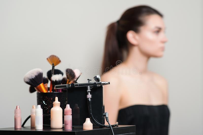 Professional makeup brushes, modern airbrush and tools. Make-up products set. Make up application tools. Cosmetics and brushes on royalty free stock photos