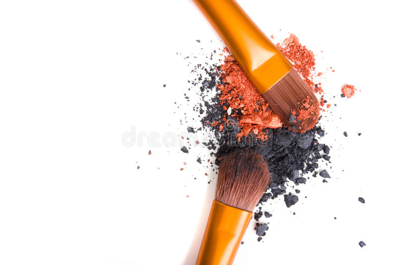 Professional makeup brushes set and loose powder eyeshadows isol royalty free stock photo
