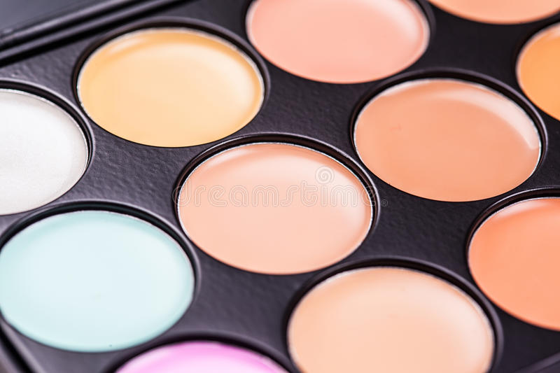 Professional makeup concealer cosmetics. Close up image royalty free stock image