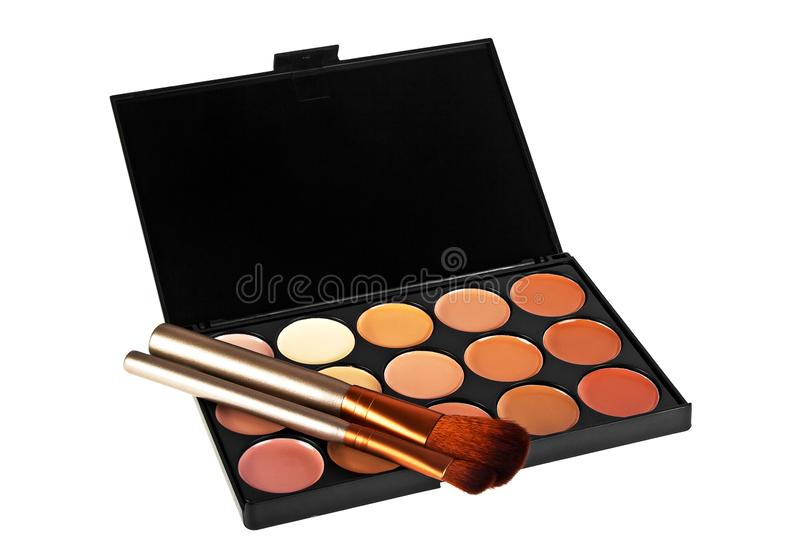 Professional makeup tools on a white background, palette for makeup and cosmetic brushes stock photo