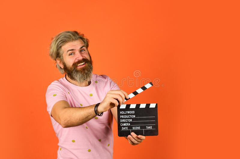 Professional male actor ready for shooting film. prepares for new scene. producer holding movie clapperboard. action. Hipster man with movie clapper. Man stock photos