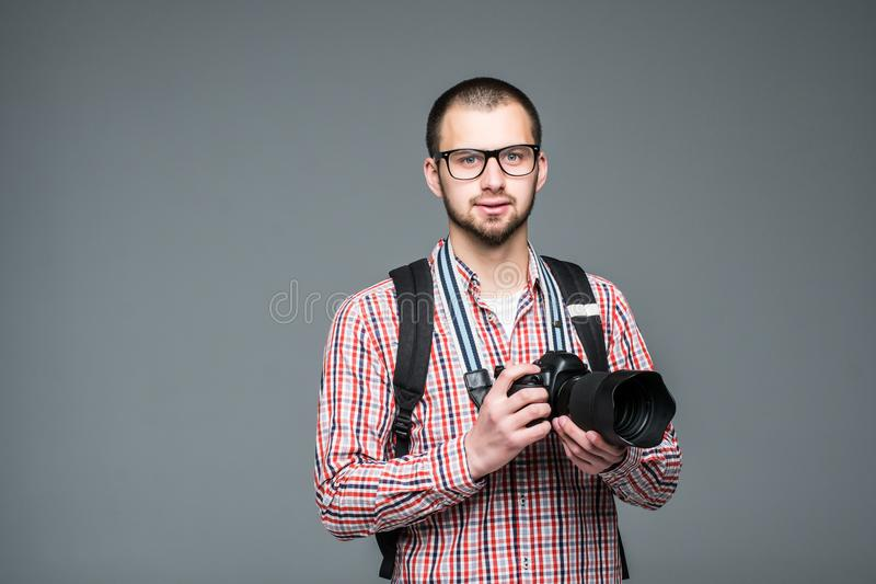 Professional male photographer with digital photo camera isolated on grey royalty free stock photos