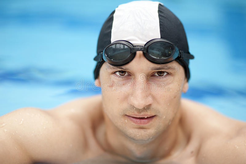 Professional male swimmer. Wearing a hat and goggles royalty free stock images