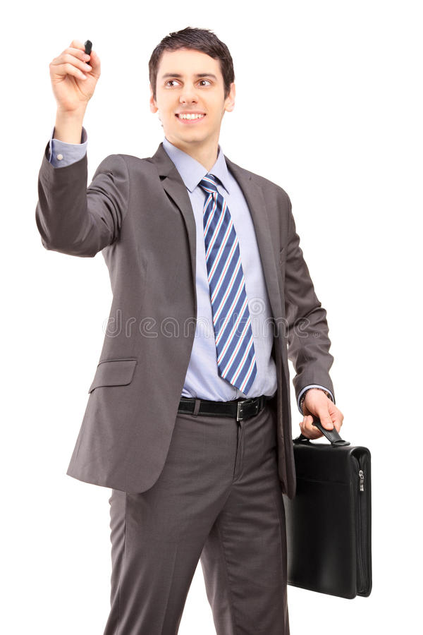 Download Professional Man With A Briefcase Writing Something Imaginary Stock Photo - Image: 29907758