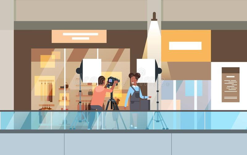 Professional man photographer using dslr camera on tripod shooting african woman model girl posing in modern shoping vector illustration